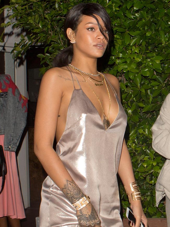 Rihanna wearing a silver silk dress was seen leaving Giorgio Bal