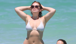 British vlogger Tanya Burr has an unfortunate bikini malfunction as she wades into the ocean in Miami